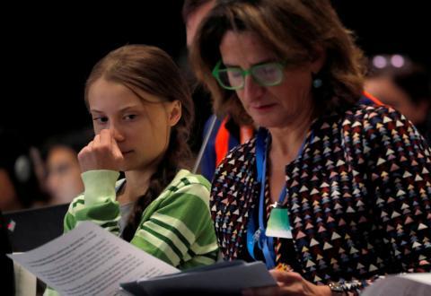 La activista Greta Thunberg junto a Teresa Ribera en la COP25.