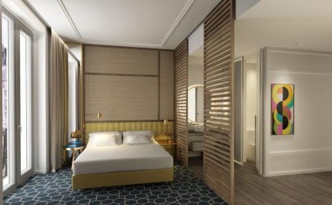 Las habitaciones se abren a la mítica Gran Vía madrileña.
