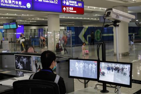 A health surveillance officer monitors passengers arriving at the Hong Kong International Airport on January 4, 2020.