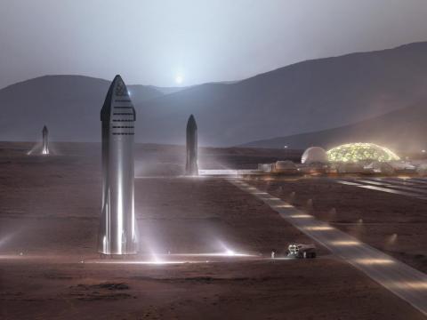 Una ilustración de los cohetes Starship proyectados por SpaceX en las plataformas de lanzamiento de una ciudad de Marte.