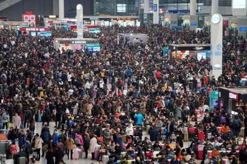 Passengers waiting to board trains at Shanghai's Hongqiao Railway Station ahead of the Lunar New Year in February 2018.
