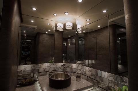 The rear bathroom includes mirrors, a sink …