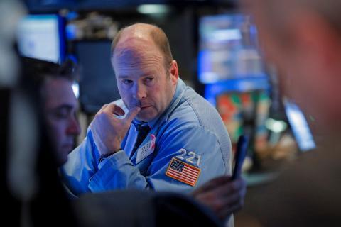 Trader trabajando en Wall Street.