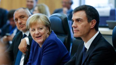 Angela Merkel y Pedro Sánchez.