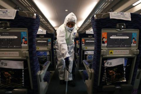 A disinfection worker wearing protective gears spray anti-septic solution in an train amid rising public concerns over the spread of China's Wuhan Coronavirus at SRT train station on January 24, 2020 in Seoul, South Korea.