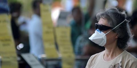 A passenger wearing a medical mask at a Bali airport.