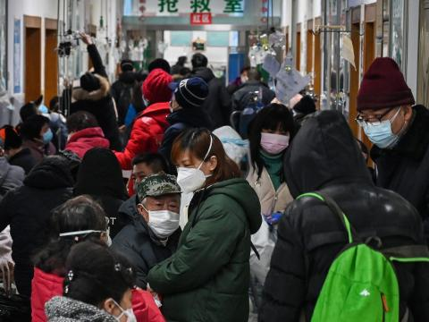 People wait for medical attention at Wuhan Red Cross Hospital on January 25, 2020.