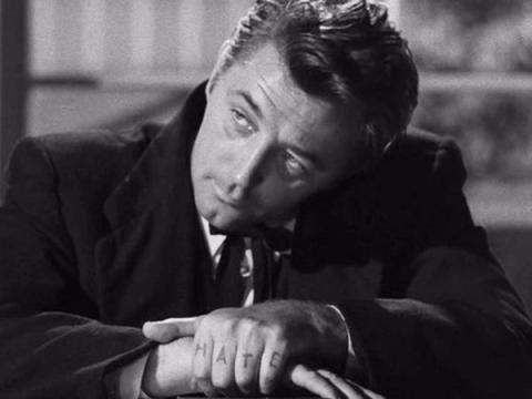 Robert Mitchum en La noche del cazador.
