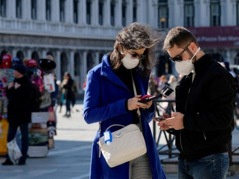 People in Italy wearing face masks.
