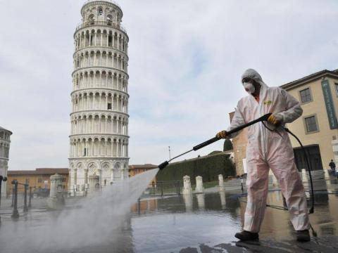 AFTER: The only people around the Leaning Tower during Italy's lockdown are workers spraying disinfectant solutions around public spaces.