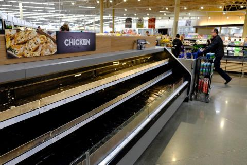 Empty shelves are seen at the Meijer store on Monday, March 16, 2020, in Whitestown, Indiana, amid the coronavirus outbreak.