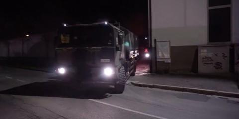 An Italian military truck leaving a crematorium in Bergamo, Italy, on Wednesday night.