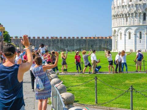 BEFORE: The Leaning Tower of Pisa in Italy attracts throngs of tourists pretending to hold it up.