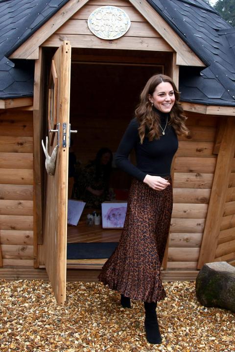Kate Middleton paired a black turtleneck with a $13 Zara animal print skirt.
