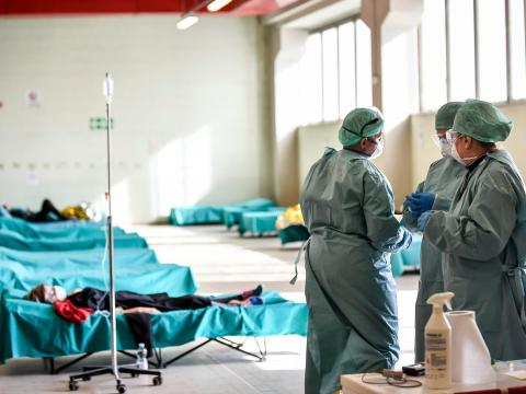 Medical personnel work inside one of the emergency structures that were set up to ease procedures at the hospital of Brescia, Italy, on March 10, 2020.