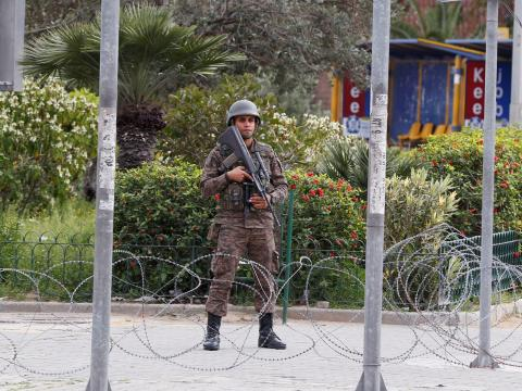 A soldier stands in downtown Tunis on March 24, after Tunisia's president ordered the army to patrol the streets and enforce lockdowns to stop the spread of coronavirus.