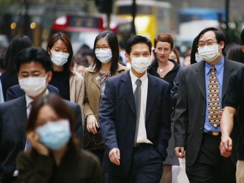 People wear surgical masks to try to reduce the chance of infection from SARS in Hong Kong in 2003.
