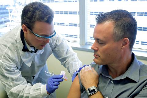 Neal Browning gets a shot of the vaccine.