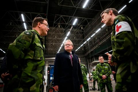 Swedish Defense Minister Peter Hultqvist visits the site of a new field hospital for COVID-19 patients in Stockholm on March 27.