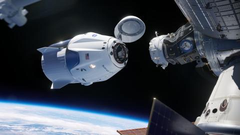 La ilustración de un artista muestra la nave espacial SpaceX Crew Dragon acoplándose a la Estación Espacial Internacional.
