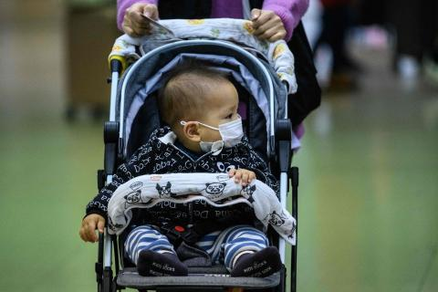 A baby wearing a protective face mask in Hong Kong, on February 3, 2020.