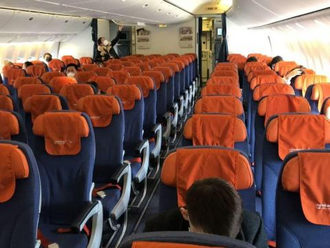 Social-distancing measures could make airfare rise.
