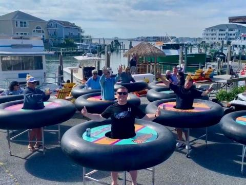 A group strolled around Ocean City to celebrate the unveiling of the tables.