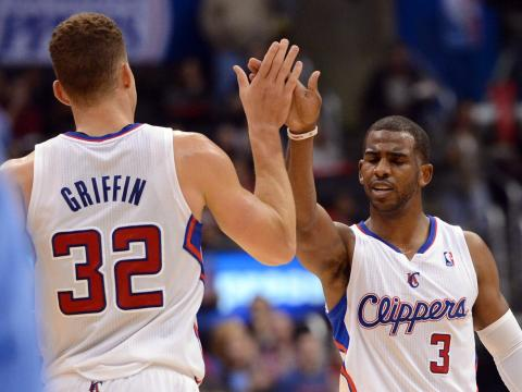 LA Clippers players high-five each other.