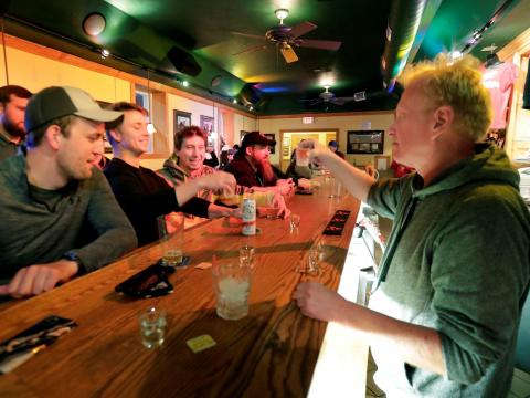People toast the reopening of the Friends and Neighbors bar in Appleton, Wisconsin, following the Wisconsin Supreme Court's decision to strike down Gov. Tony Evers' safer-at-home order on May 13.