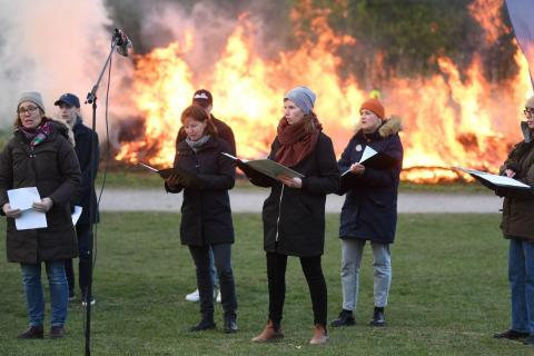 A local scout association live streams traditional Walpurgis Night celebrations with bonfire and a choir in Bromma, northern Stockholm, Sweden, on April 30, 2020, amid the novel coronavirus pandemic. Walpurgis Night in Sweden is a traditional religious