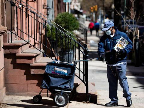 A United States Postal Service worker delivering mail in Philadelphia on April 2.