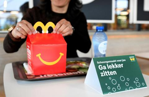 McDonald's said that it might roll out table service, serving customers on trolleys where they can pick up their order instead of directly interacting with employees.