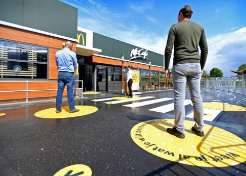 McDonald's is testing decals to promote social distancing among customers.
