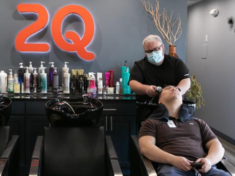 A man washes a customer's hair at a hair salon in Atlanta on April 27.