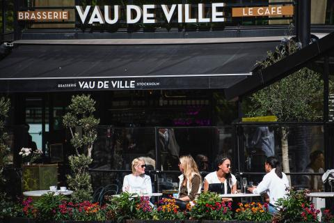 People sit in a restaurant in Stockholm on May 8, 2020, amid the coronavirus pandemic.