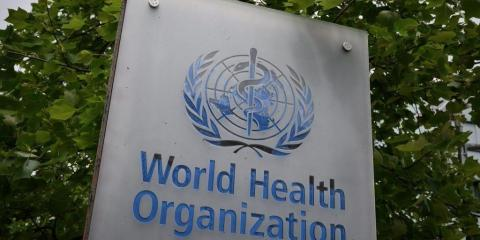 This picture taken on May 12, 2020, shows a sign of the World Health Organization (WHO) in Geneva next to their headquarters, amid the COVID-19 outbreak, caused by the novel coronavirus.