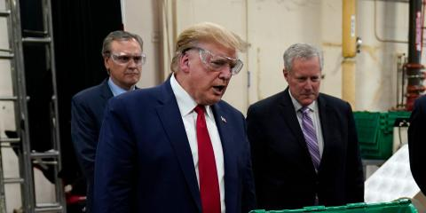 President Donald Trump, Honeywell International VP Tony Stallings, and White House chief of staff Mark Meadows tour a Honeywell plant manufacturing personal protective equipment in Phoenix, Arizona, on May 5, 2020.