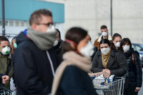 Residents wait to be given access to shop in a supermarket in small groups of forty people on February 23 in the small Italian town of Casalpusterlengo.