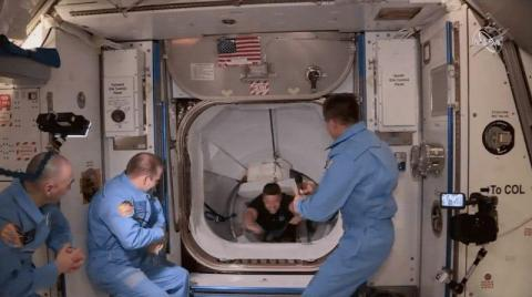 NASA astronauts Bob Behnken and Doug Hurley float into the International Space Station on May 31, 2020, after riding SpaceX's Crew Dragon spaceship to the orbiting laboratory.