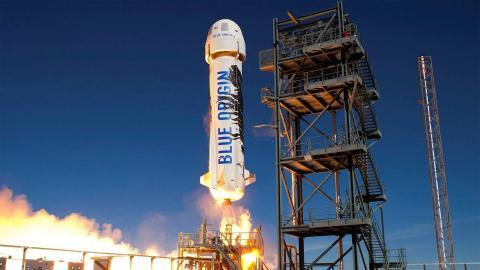 Blue Origin's reusable New Shepard suborbital rocket launches toward space in 2016. Blue Origin
