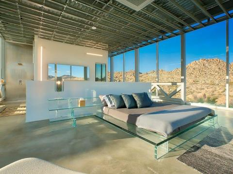 Each of the four bedrooms boasts unobstructed views of the property, en-suite bathrooms ...