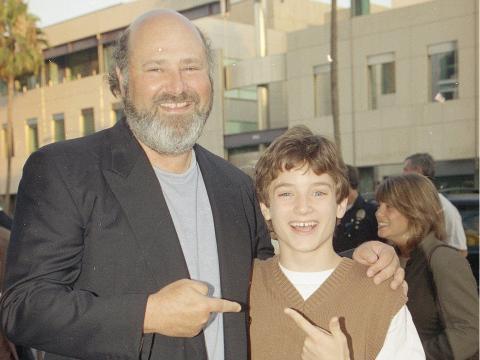 El director Rob Reiner con Elijah Wood.