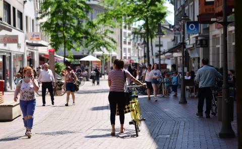 Citizens walk at the pedestrian zone in Guetersloh, western Germany on June 23, 2020.