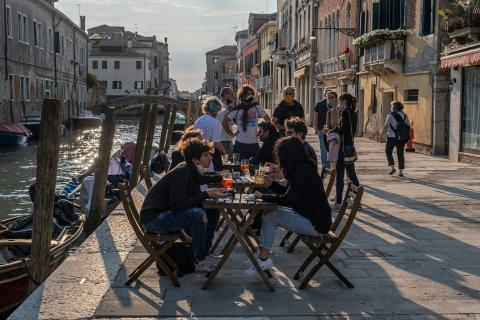 Venetians drink the aperitif in a bar on May 20, 2020 in Venice, Italy.