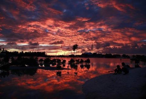 Sunset over a small lagoon near the village of Tangintebu on South Tarawa, Kiribati.