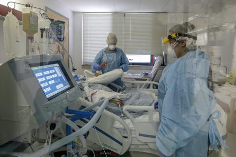 Nurses attend to a COVID-19 patient on ventilator at Desert Valley Medical Group. Victorville, CA.