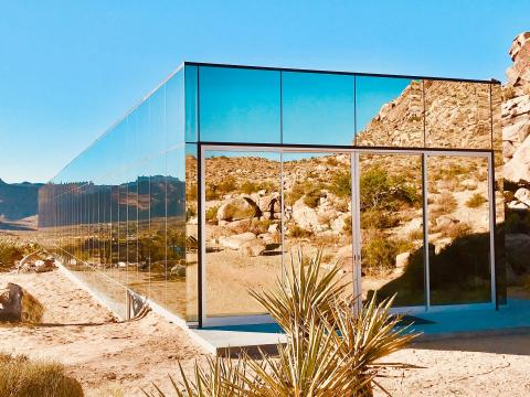 The producer of the cult classic movie 'American Psycho' designed a home in Joshua Tree that looks like a fallen skyscraper, and it's almost entirely covered in mirrors. Take a look inside.