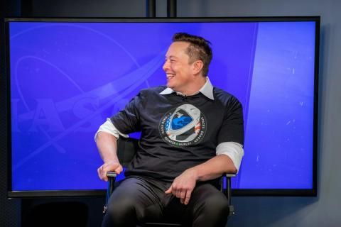 SpaceX founder Elon Musk participates in a postlaunch news conference inside the Press Site auditorium at NASA's Kennedy Space Center in Florida on May 30, 2020, following the launch of the agency's SpaceX Demo-2 mission to the