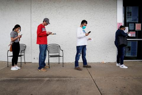 People wait in line to file for unemployment at an Arkansas Workforce Center in Fayetteville, Arkansas, on April 6, 2020. Nick Oxford/Reuters