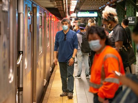 People wearing masks wait on a crowded subway platform on May 30, 2020, in New York City. Alexi Rosenfeld/Getty Images